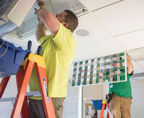 workers install new lighting at Cleveland Clinic