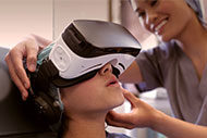 Patient using virtual reality therapy for pain management
