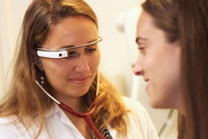 Doctor examining patient wearing Google Glass tech