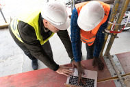 Construction managers looking at laptop