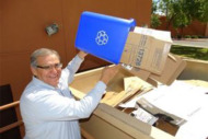 Man putting waste into recycling bin