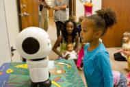 Children looking at Maki robot