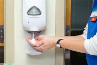 RN using soap dispenser