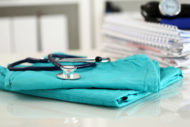 Folded hospital scrubs