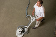 ChemDry technician cleaning carpet