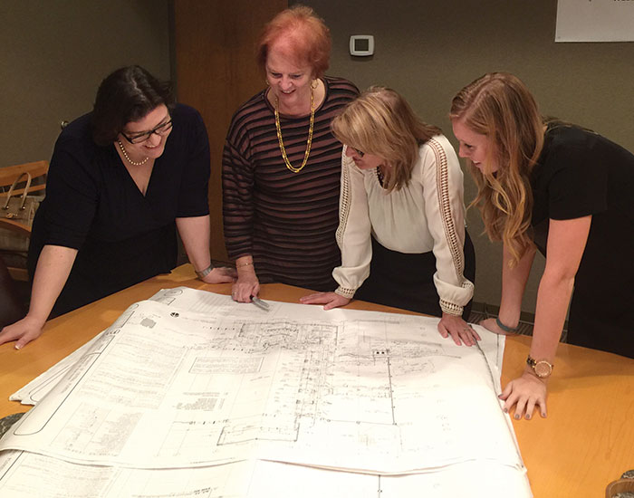 staff looking at blueprints