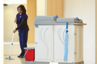 Mopping hospital floor with machine in foreground