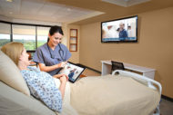 Nurse and patient looking at TVR Communication system