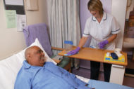 Environmental services worker in patient room