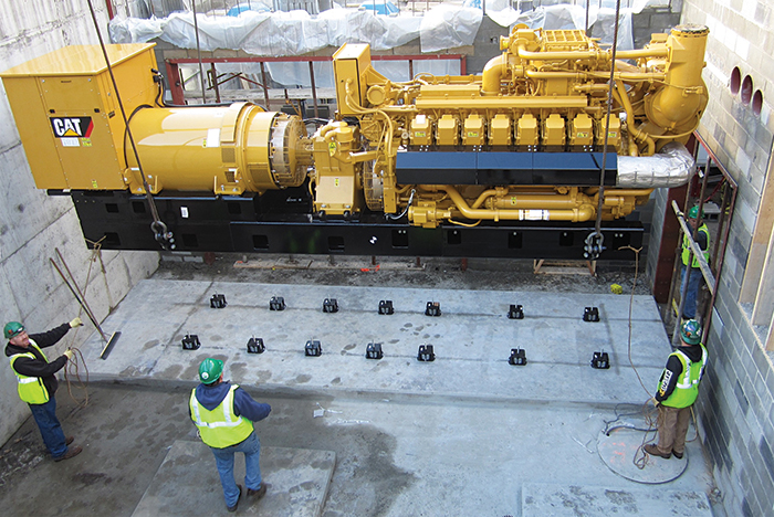generator set being lifted into a mechanical pit