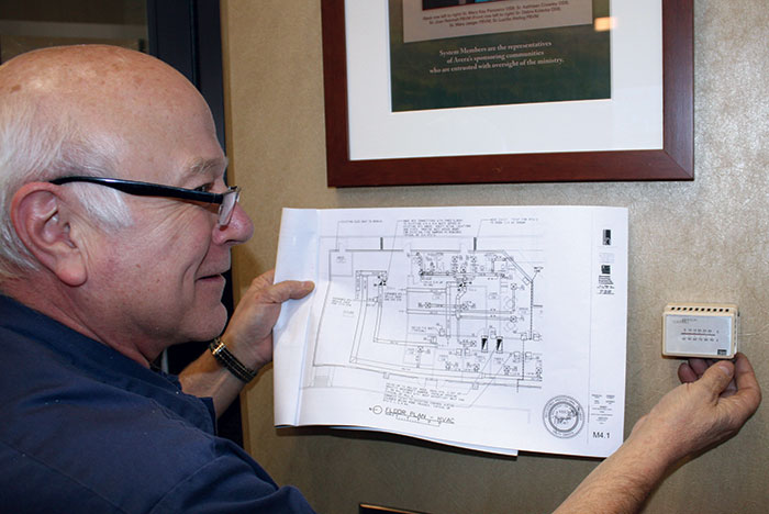 Jim Kent of Avera Health System checks a thermostat