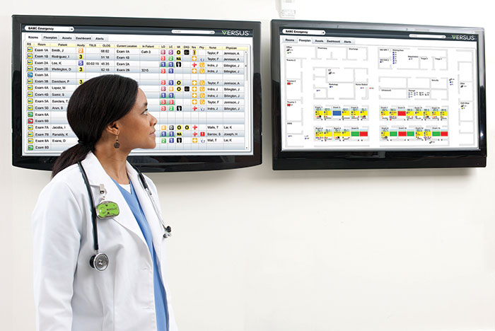 female clinician viewing RTLS screens