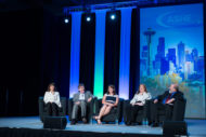 Panel experts sitting on stage at ASHE Annual Conference