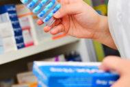 Pharmaceutical worker holding meds