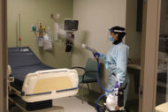 EVS worker spraying electrostatic disinfection