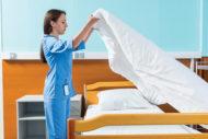 EVS tech making patient bed