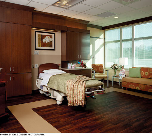 Laminate panels, designed with input from hospital staff, improve the look and functionality of the headwall in the patient rooms.