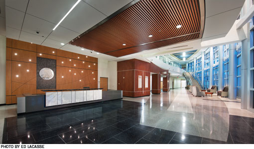 Interior entrance lobby of the hospital.  Tall ceilings and floor to ceiling windows make the lobby feel spacious