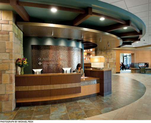Lobby desk of St. Anthony Hospital.  Wood panels and stone tile highlight the natural environment of Colorado.