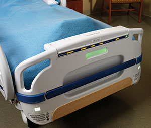 The foot of a modern hospital bed with a small digital display embedded into it