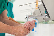Medical practitioners wash their hands