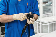 Doctor holding an endoscope