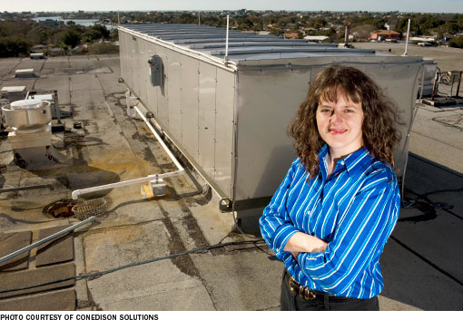 Elena Ress, an engineer with ConEdison Solutions, on the roof of Largo (Fla.) Medical Center, where the company provided energy services.